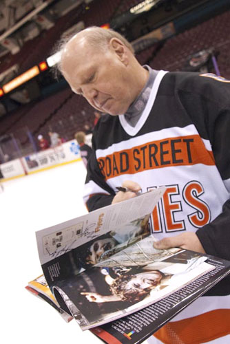 "Bob Kelly, takes a look through the pages of the recently published tribute book titled God Bless The Spectrum. Kelly and several teammates from the Flyers' Stanley Cup Championship teams, participated in a ""Final Skate"" at The Spectrum on April, 11. Kelly signed autographs, posed for pictures and chatted with fans during the two-hour session. photography: © roger barone 2009"