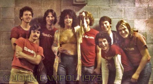 Grace Slick of Jefferson Starship poses backstage with Spectrum Arena changeover crew employees, photo © John Campoli