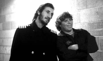 Mike Nolan, first cousin of Flyers' PA announcer Lou Nolan, poses with Who guitarist Pete Townsend backstage at The Spectrum. PHOTO: © roger barone 1975