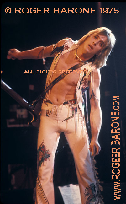 Mick Ronson, shirtless, performing at the Spectrum Arena in Philadelphia (5/9/1975) © roger barone