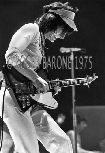 Ronnie Wood rejoined Rod Stewart and Faces for a fall tour. Wood replaced former Stones' guitarist Mick Taylor, who quit the group in 1974. Wood eventually became a full-time member of the Rolling Stones. © ROGER BARONE 1975.