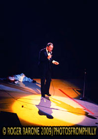 Frank Sinatra shares the stage with a Raggedy Anne doll and a trio of shadows during a visit to the Spectrum on September 22, 1975. © ROGER BARONE 2009