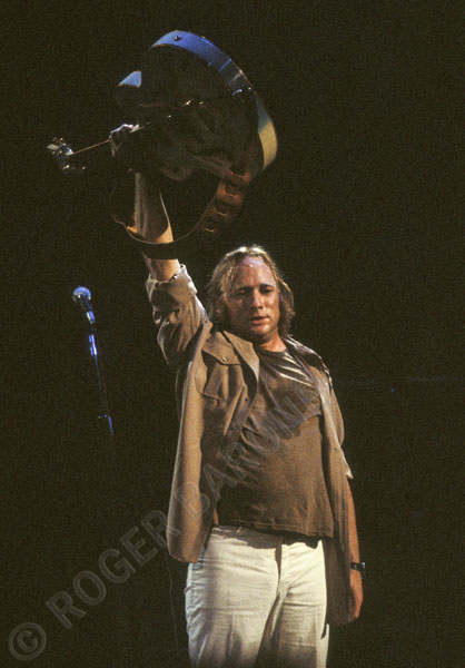 "Stephen Stills raises the White Falcon after playing ""Teach your children"" with Crosby, Stills and Nash at the Spectrum in August of 1982. © ROGER BARONE 1982"