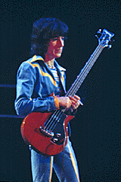 Bill Wyman, an original member of the Rolling Stones, dutifully plays his bass as Mick Jagger frolics about the stage. © ROGER BARONE/2009