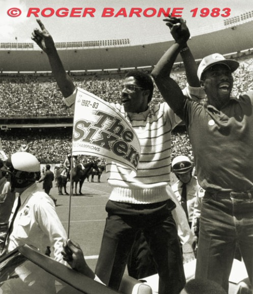 "Julius ""Dr.J"" Erving waves to fans during 76ers' championship celebration at Veterans Stadium in Philadelphia. © ROGER BARONE 1983"