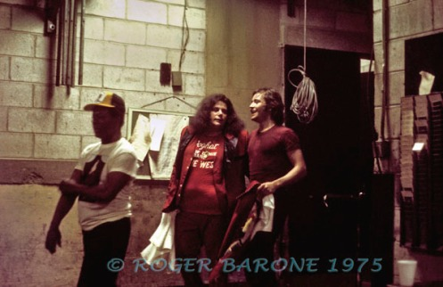 Leslie West, guitarist with Mountain and West, Bruce and Lange, heads to the dressing room backstage at the Spectrum after performing as the opening band for Carlos Santana. © ROGER BARONE 1975