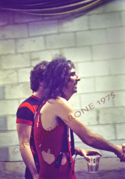"Alice Cooper walking with beer in hand moments before taking the stage at The Spectrum during his ""Welcome to My Nightmare"" tour. Cooper wore a Flyers' jersey as a tribute to the Stanley Cup champions © roger barone1975"