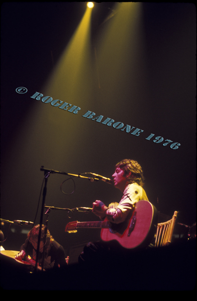 Paul McCartney performs a couple of solo acoustic songs during the Wings performance at The Spectrum. McCartney is pictures with an Ovation guitar. © ROGER BARONE 1976
