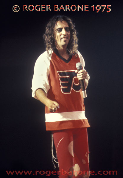 "Alice Cooper pays tribute to the '74-'75 Stanley Cup Champion Philadelphia Flyers during his ""Welcome to My Nightmare"" tour at the Spectrum © ROGER BARONE 1975"