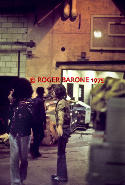 Mick Jagger and Billy Preston direct band mates to the dressing rooms after arriving at the Spectrum. © ROGER BARONE 1975