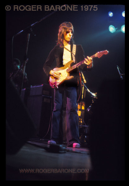 Jeff Beck is bathed in colorful lights as he plays his Fender stratacaster at the Spectrum. John McLaughin was the opening performer at this show in 1975. © ROGER BARONE
