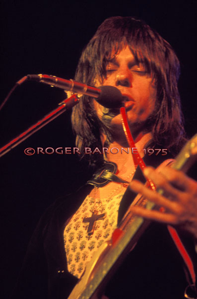"Jeff Beck alters the sound of his voice using a squawk box during Stevie Wonder's hit ""Superstition"" at The Spectrum. ©ROGER BARONE 1975"