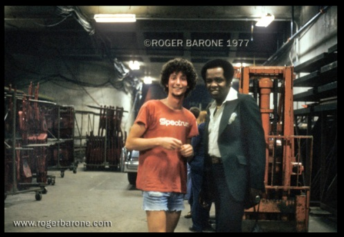 Lou Rawls poses backstage with Spectrum changeover crew employee Clem DiBattista. Clem was promoted to Zamboni Machine driver several years later. © ROGER BARONE 1977