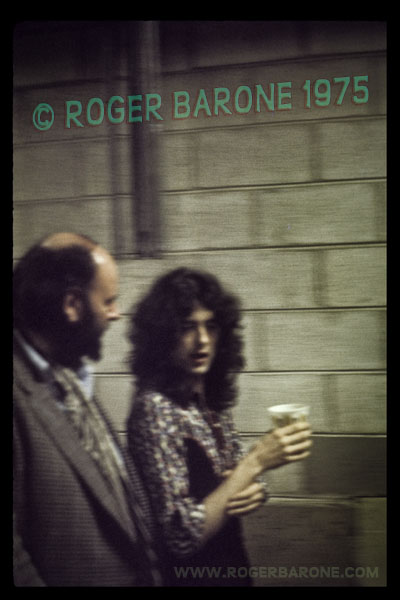 Jimmy Page fingers chord patterns on his right arm while Led Zeppelin prepares to take the stage at The Spectrum. © ROGER BARONE 1975