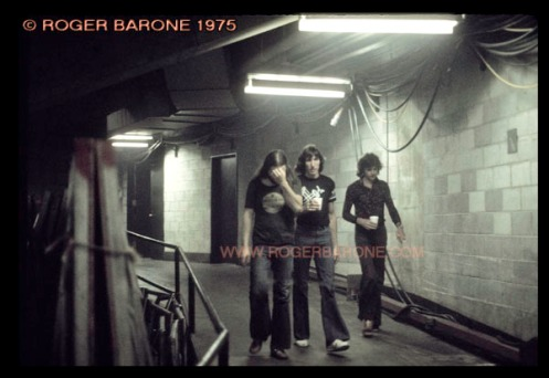 David Gilmore, Roger Waters and Richard Wright of Pink Floyd, make their way to The Spectrum stage for their concert in June 1975.