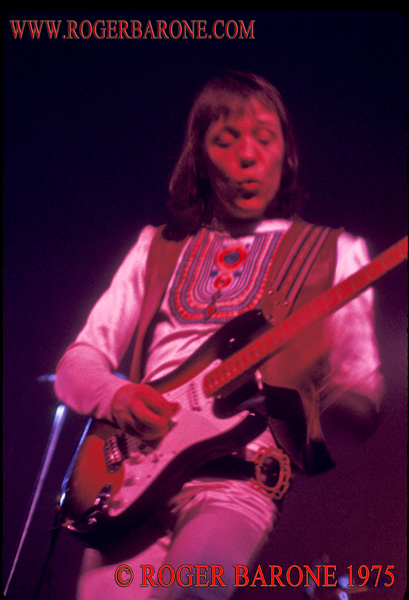 guitarist robin trower in red lighting