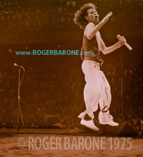 mick jagger leaping with wireless microphone at Philadelphia Spectrum Arena concert photo by roger barone