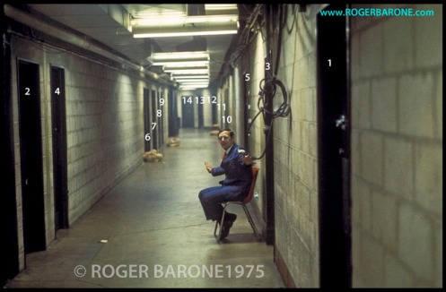 Spectrum security officer guards backstage entrance to Kinks' dressing room (4/21/1975) © roger barone photo from philly