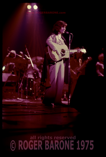 Kinks Ray Davies wear cape while performing at Spectrum Arena, Philly © Roger Barone 1975