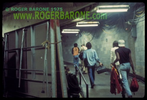 rolling stones walking backstage to Spectrum Arena dressing rooms, photo by roger barone, june 29, 1975