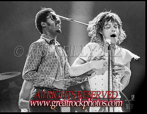 """Rolling Stones' singer Mick Jagger performs """"Uptight"""" and """"Satisfaction"""" with Motown star Stevie Wonder at the Spectrum Arena in Philly.: July 21, 1972. photo:© Art Reilly 1972"""