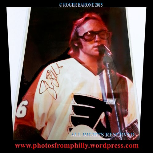 Stephen Stills wear a Philadelphia Flyers jersey while performing at Villanova University in 1975. photo: © roger barone 2015